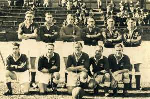 1951-je-nolan-front-row-1st-on-left-rnzn-v-auckland-reps-at-blandford-park-auckland-nz-front
