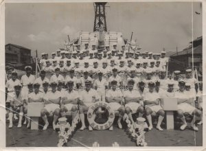 1953-04-18-hmnzs-hawea-crew-je-nolan-2nd-row-and-2nd-from-right-in-between-two-officers-and-in-front-of-air-intake-18-apr-53-07-dec-53-front