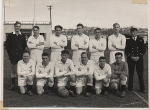 1955-07-27-je-nolan-front-row-2nd-from-left-rnzn-pos-soccer-team-sports-fields-devonport-naval-base-auckland-nz-front